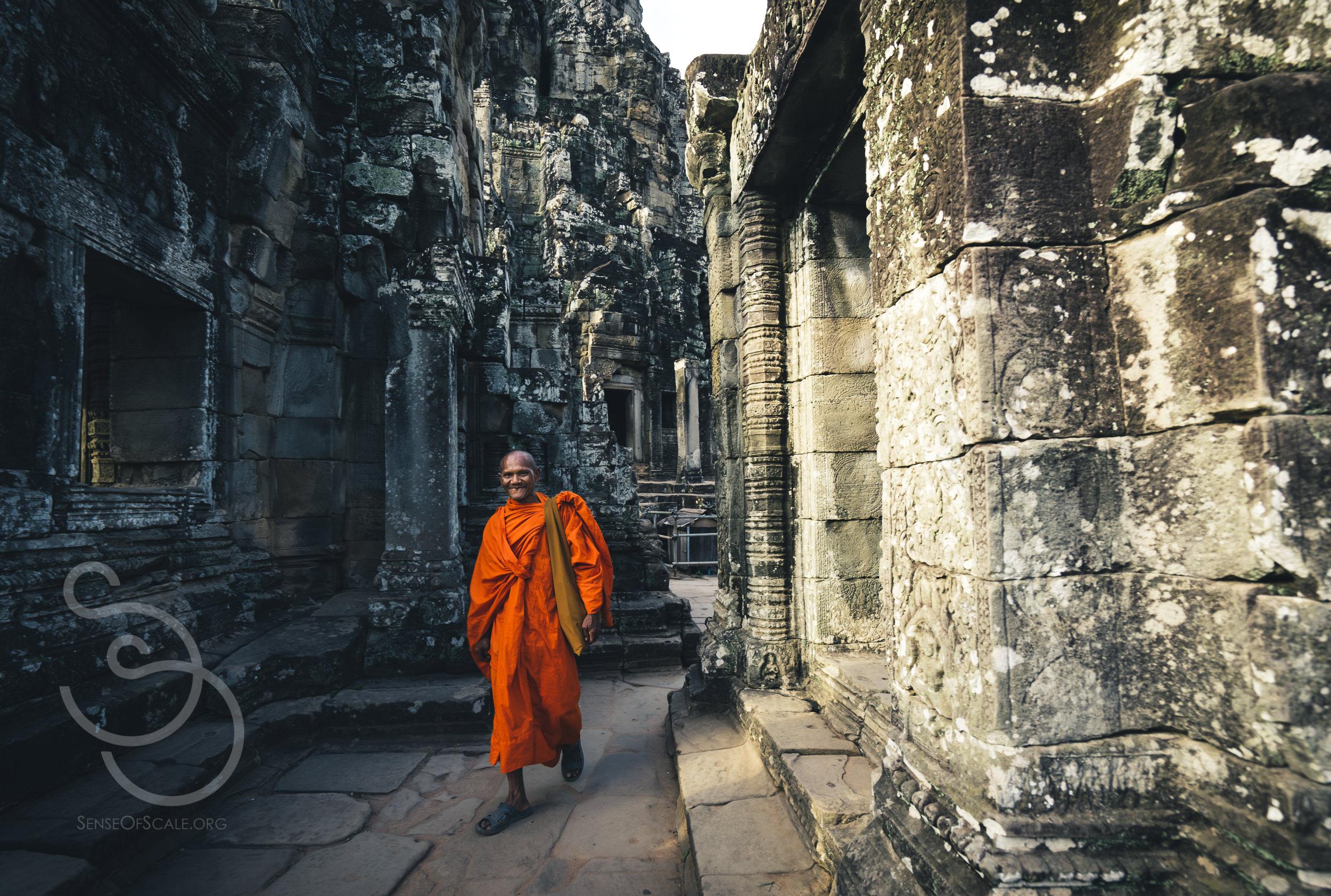 Monk walking and smiling