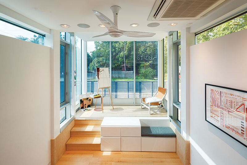 """The lifted glass front of the Kasita is called """"the Cube."""" The company describes it as """"a workspace, lounge area, or a place to fit in a little morning yoga."""""""