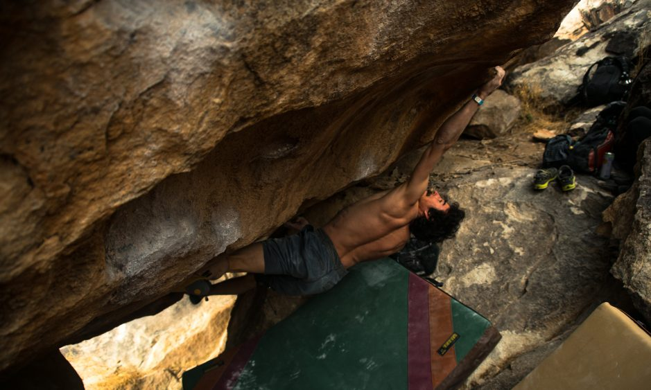 Keenan Takahashi—the winner of at Open Division at the 2018 Hueco Rock Rodeo, in Hueco Tanks, Texas—stays calm and fights off the pump on  Chupacabra Right  (V11). Photo:  Levi Harrell.
