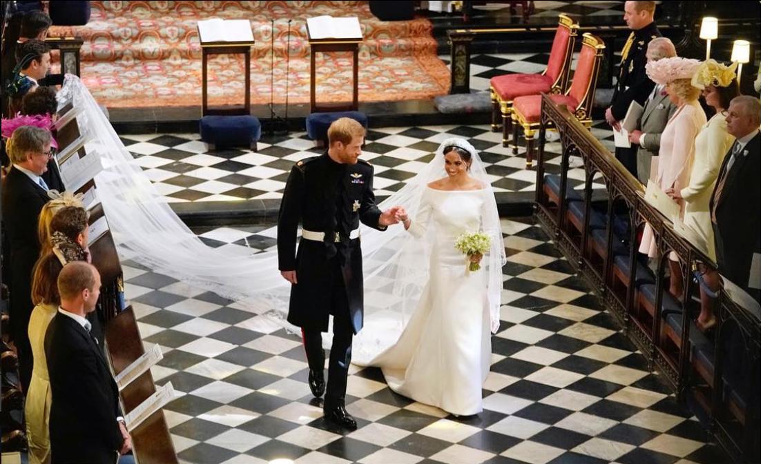 meghan markle minimalist wedding dress prince harry aisle.png