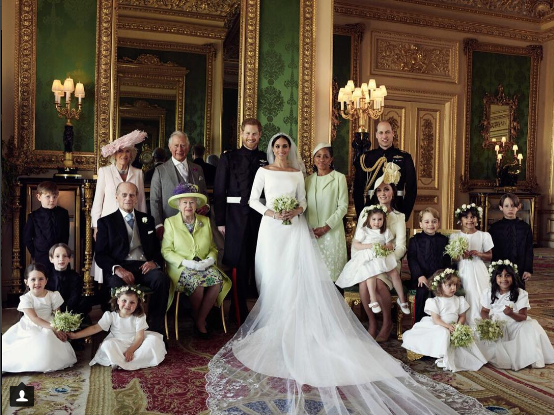 meghan markle minimalist wedding dress photo with royal family.png