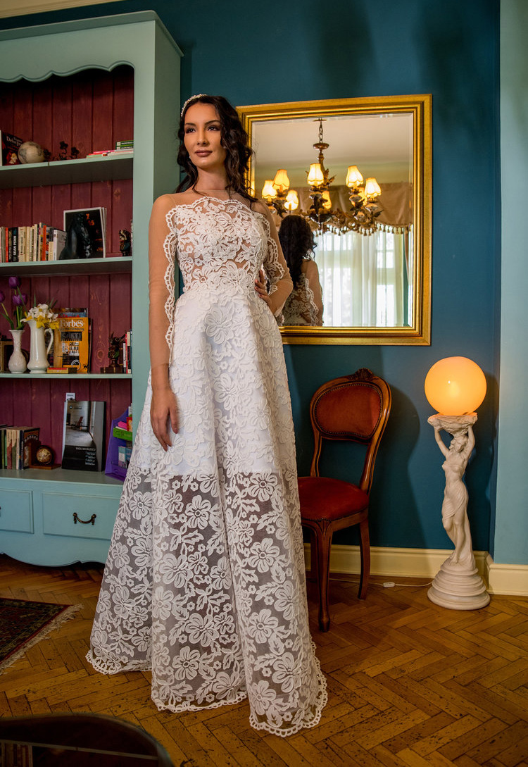 Featured: Anémone , an A-line ivory wedding dress crafted in fine floral lace with a beautiful contrast of texture and transparency.