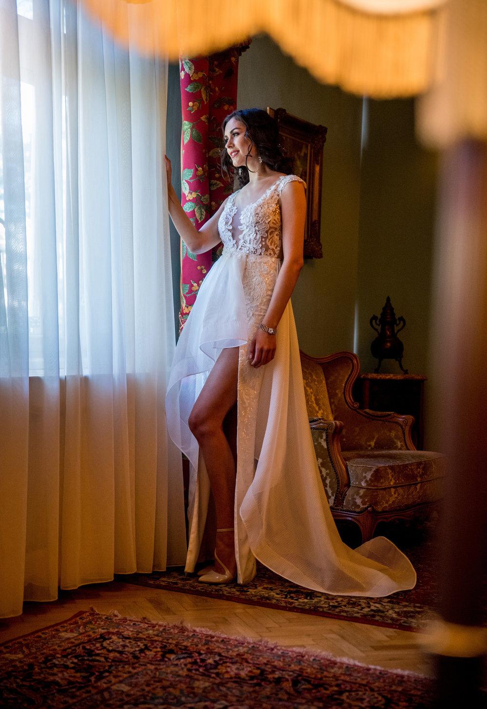 Featured:  Crocus , an A-line asymmetric wedding dress crafted in fine lace and light veil, featuring a high leg slit skirt and short train.