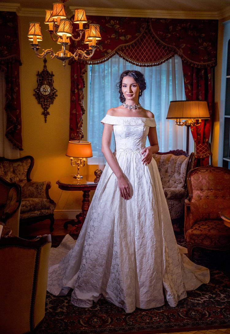 Featured :  Dahlia , a royal like ball-gown wedding dress with a lovely textured fabric and the most delicate off-shoulder detail.