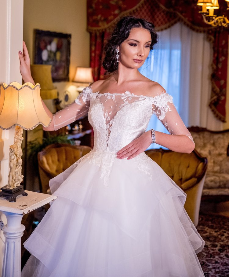 Featured:  Ceillet , princess ivory wedding dress with midi sleeves, plunging neckline and tiered skirt