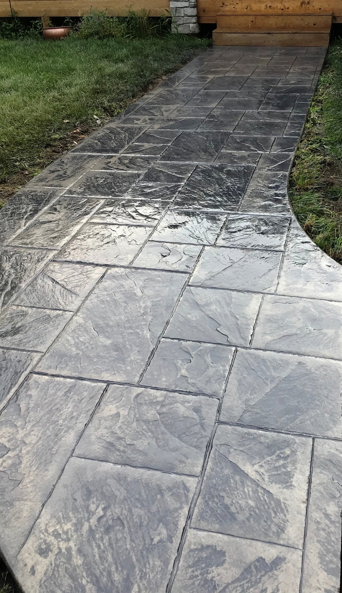 Another beautiful sidewalk installed by J & S - This sidewalk was stamped using our Large Ashler Slate stamps and colored with Deep Charcoal accents. To see more designs like this, visit our website jsgeneralcontracting.com