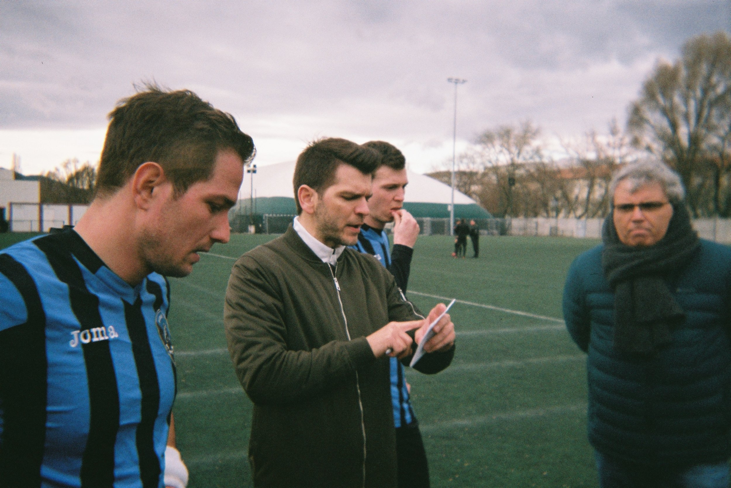 Our player-coach, Tibor Pásztor, gives instructions before a game. On the right side of the picture you can see Bertalan Molnár, the president of BAK, who re-established the traditional club last year.