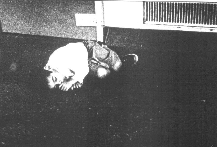 little boy tied to bed on the floor.jpg