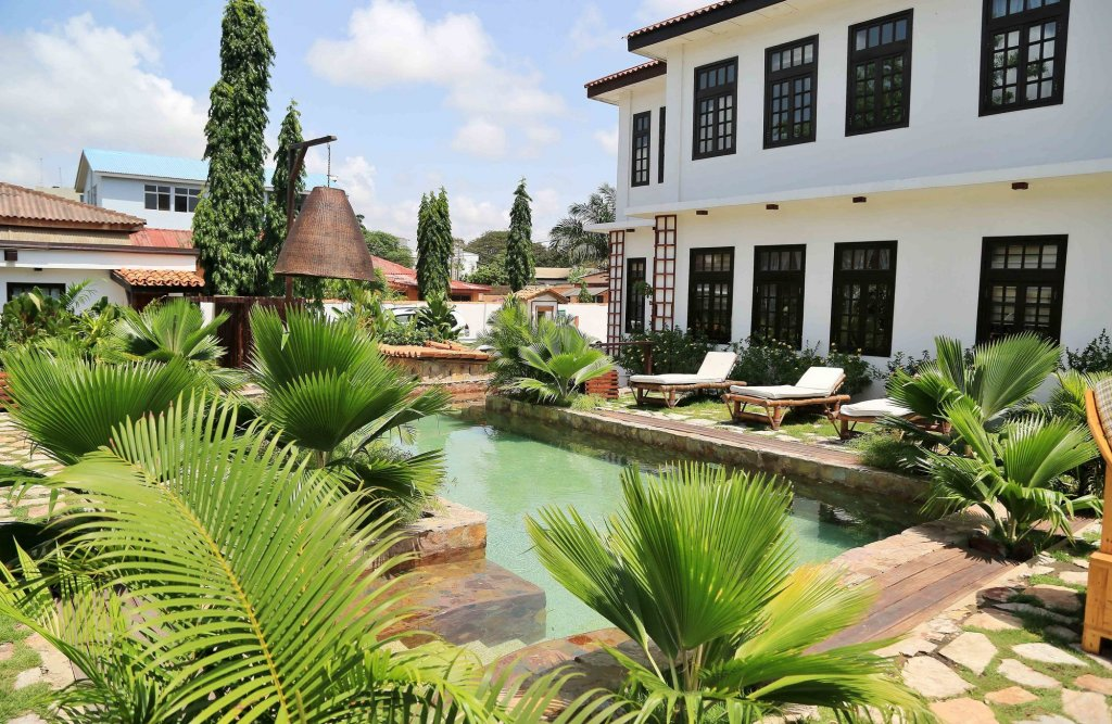 Day 1 - The Return: Arrival & Welcome Dinner - December 27, 2019 - We will pick you up from Kotoka International Airport and whisk you away to our cosy villa-stye accommodations in the Osu neighborhood of Accra. Arrival drinks will await you and as you settle into your suite, our team will be setting up for our poolside welcome dinner.At dinner you will get your first taste of Ghana with authentic Ghanian dishes. This is the perfect time to connect with the lovely travelers who you'll be exploring Ghana with for the next week.Cheers!Dinner Included