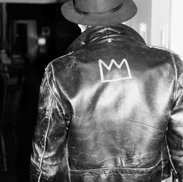 Glenn_O_Brien_in_his_Schott_Perfecto_leather_jacket_with_insignia_painted_by_Jean-Michel_Basquiat.jpg