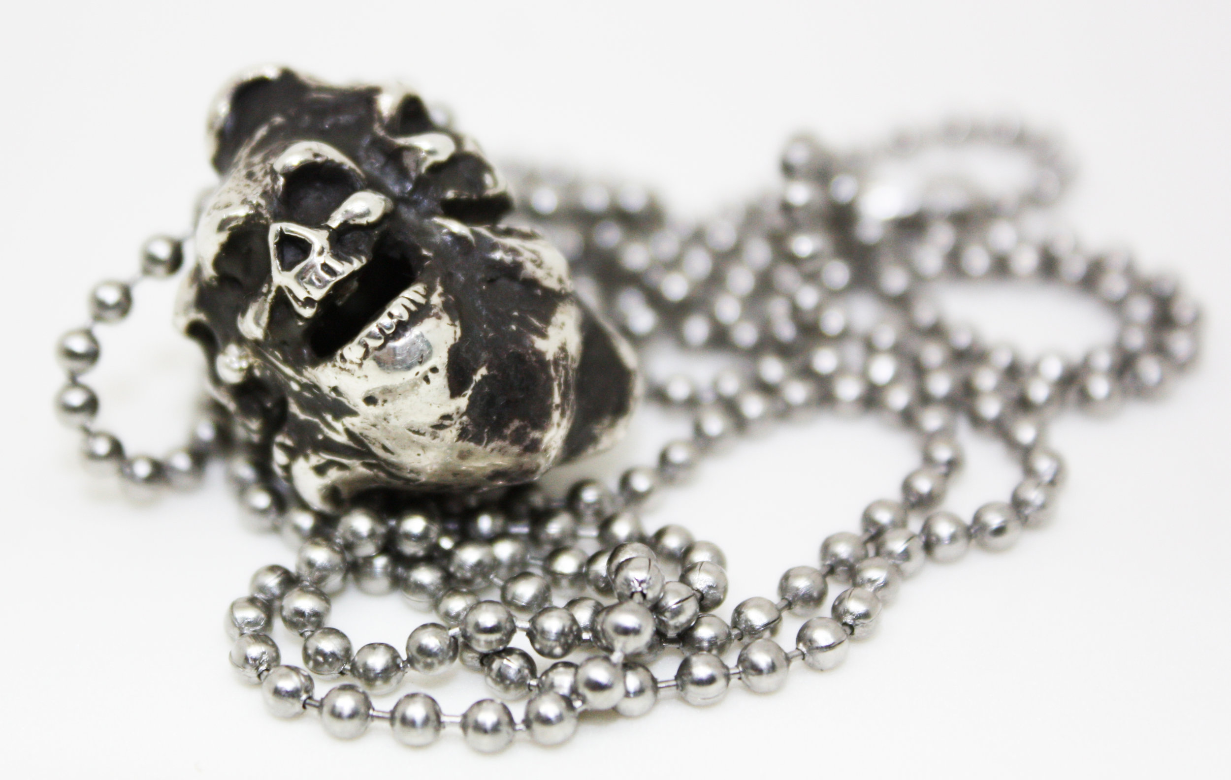 """Eternal Legend Laughing Skulls - Sterling Silver on 30"""" stainless chain. MSRP $135"""