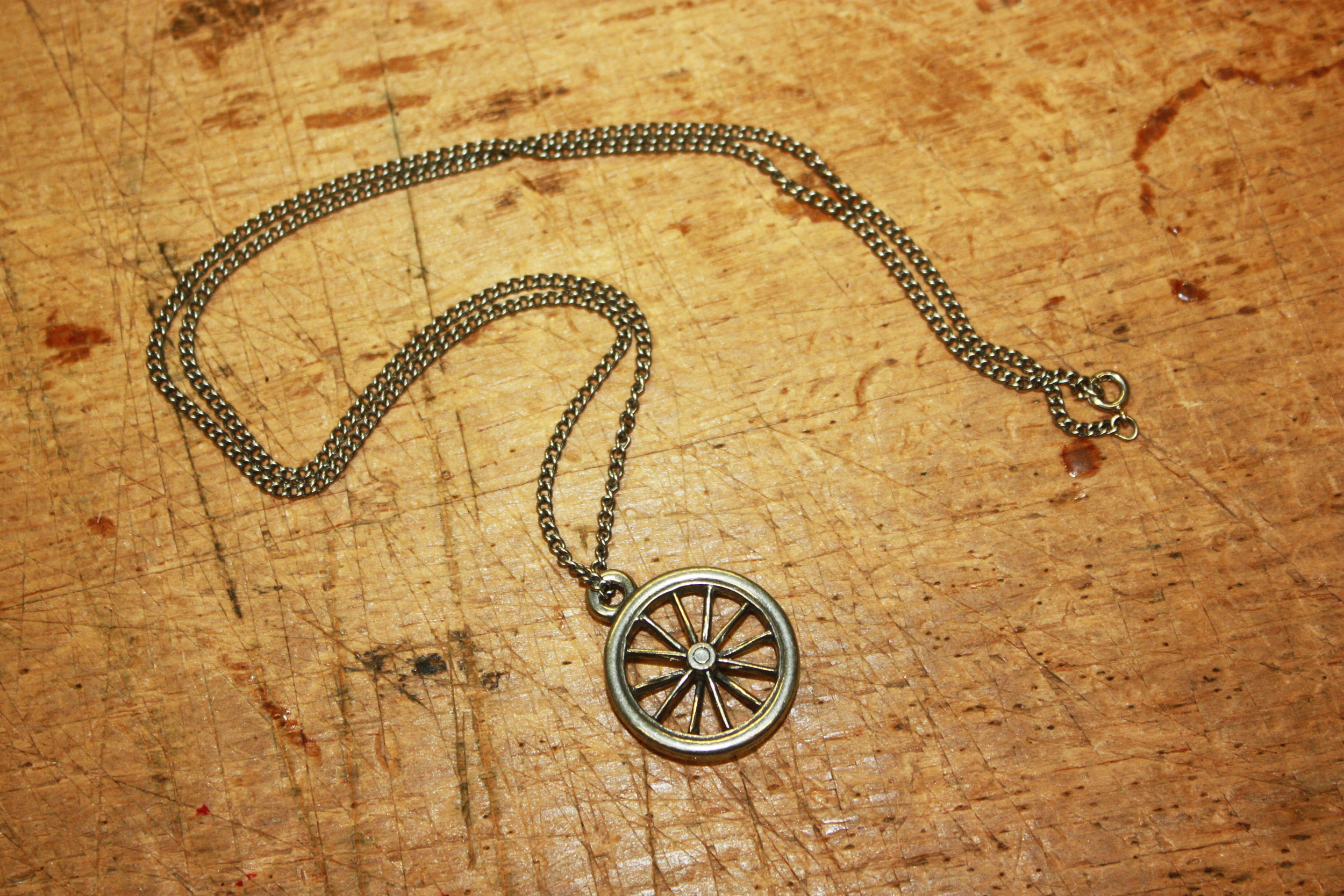 Bike Wheel Pendant - Pewter on stainless chain. MSRP $40