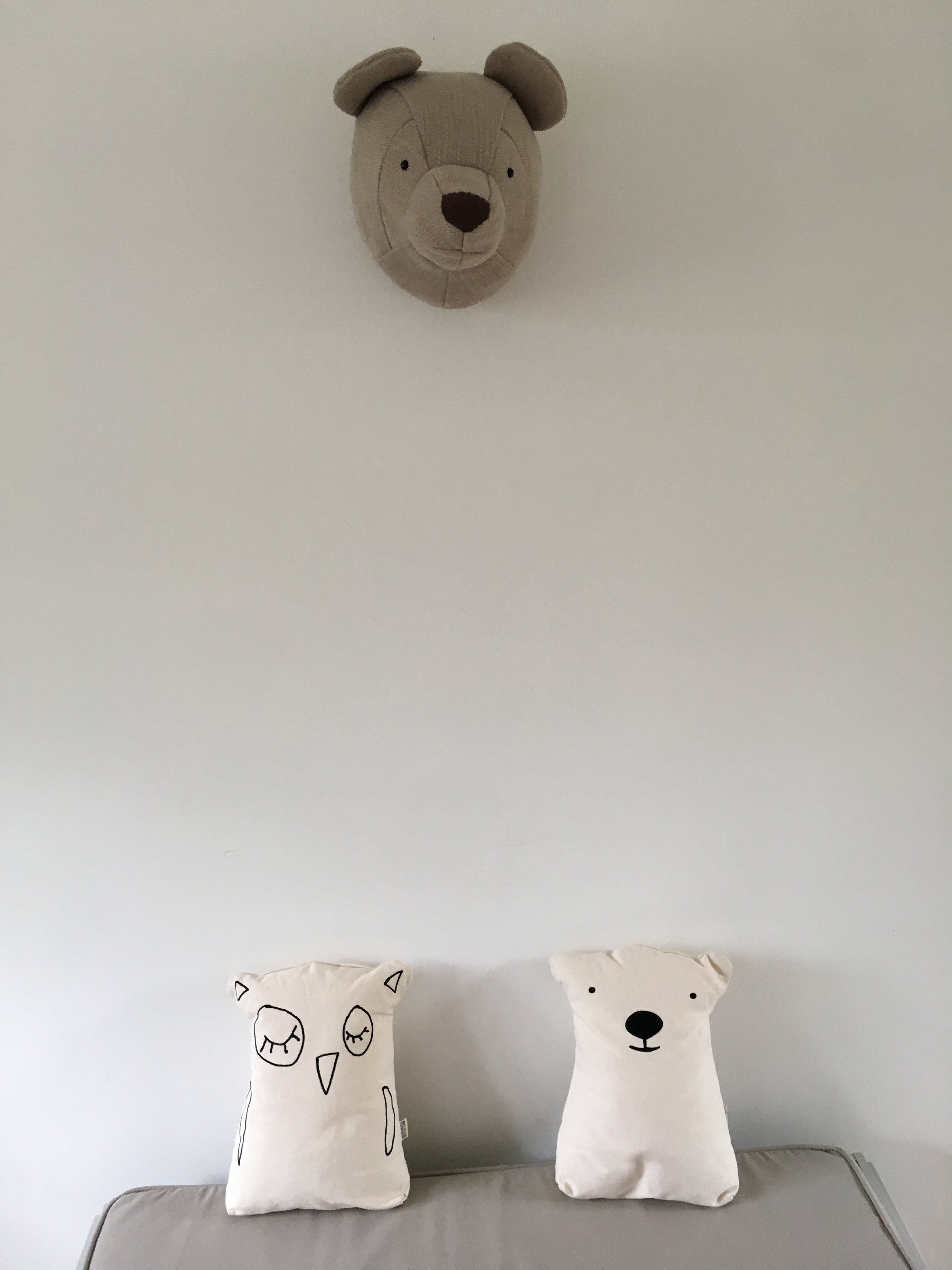 Who doesn't want a bear head in their bedroom. You can get this little grizzly  here