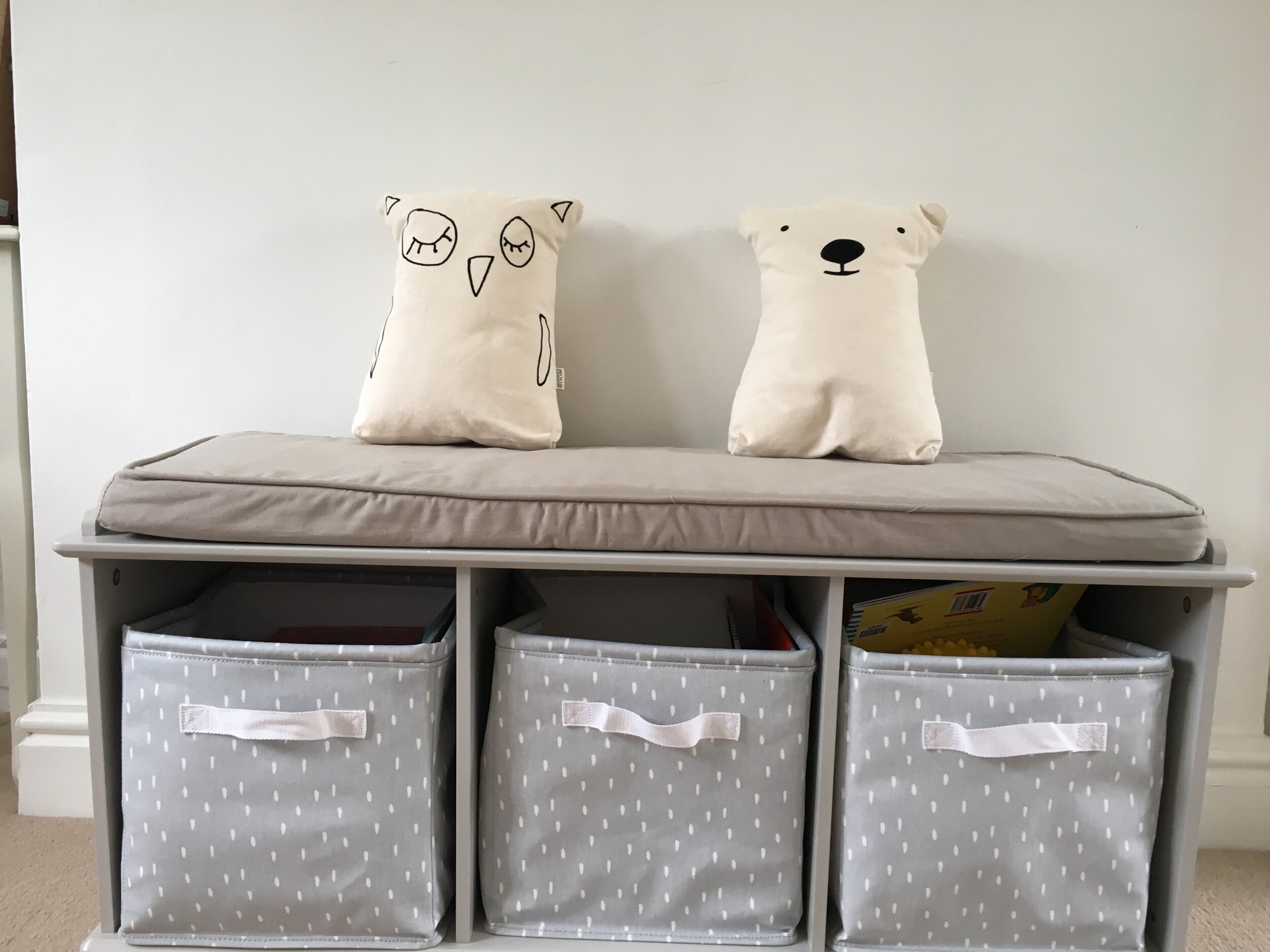 How can you make a storage area look better? Invest in some beautiful woodland theme cushions to put on top of it! We love this owl and bear ensemble!