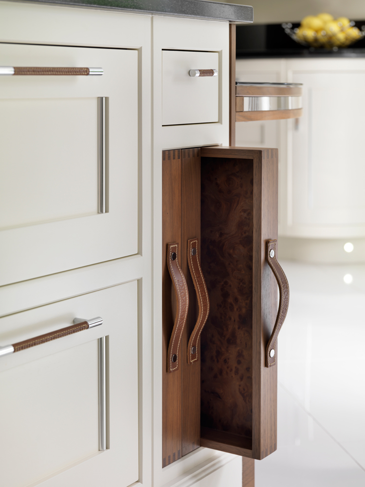 An off-white kitchen looks sensational with Walnut accents and handles.
