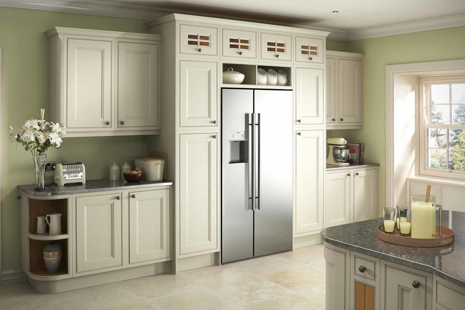 an american style fridge freezer has been cohesively integrated into this traditionally designed kitchen.