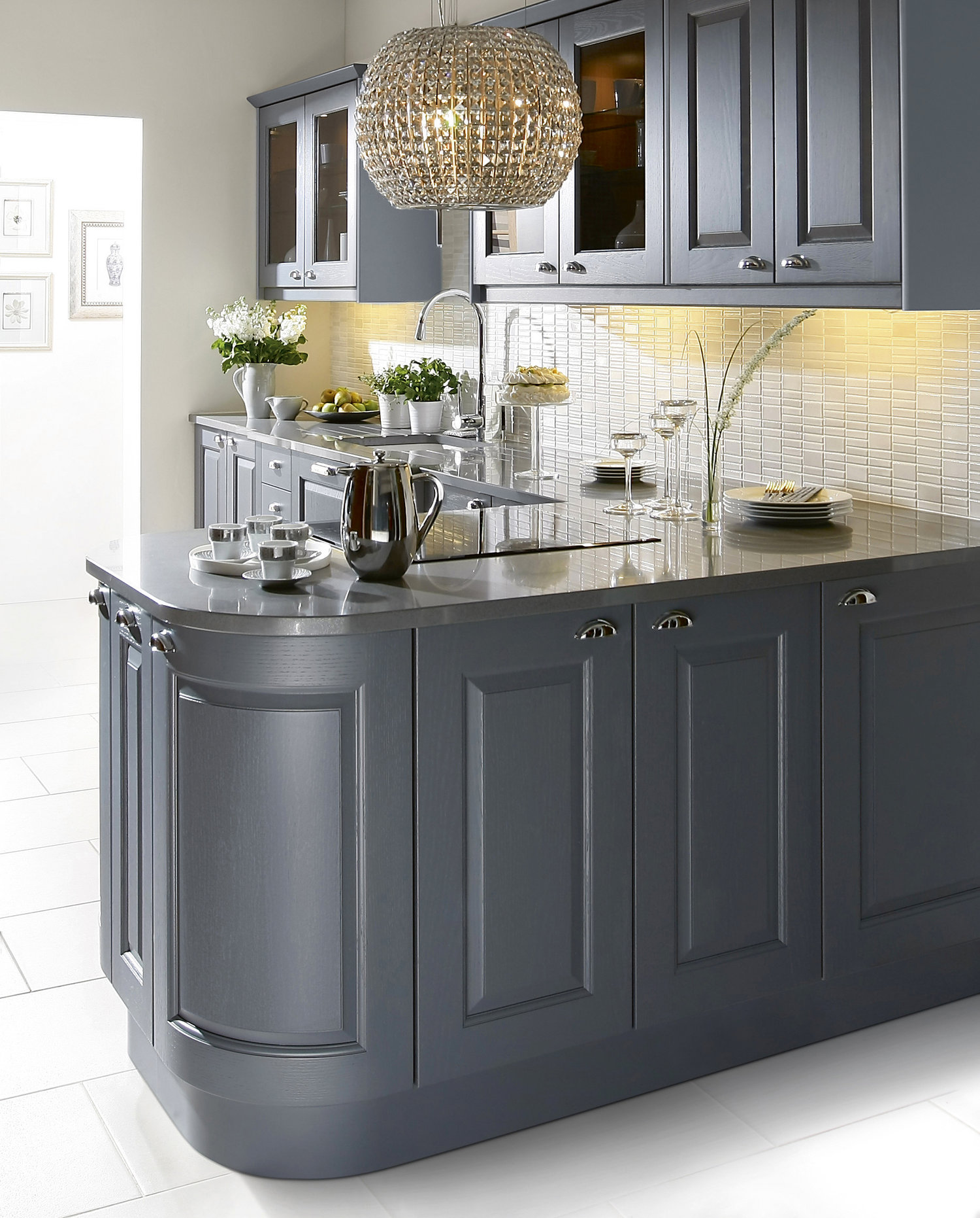 feature curved door profiles are seamlessly incorporated into a raised and fielded kitchen.