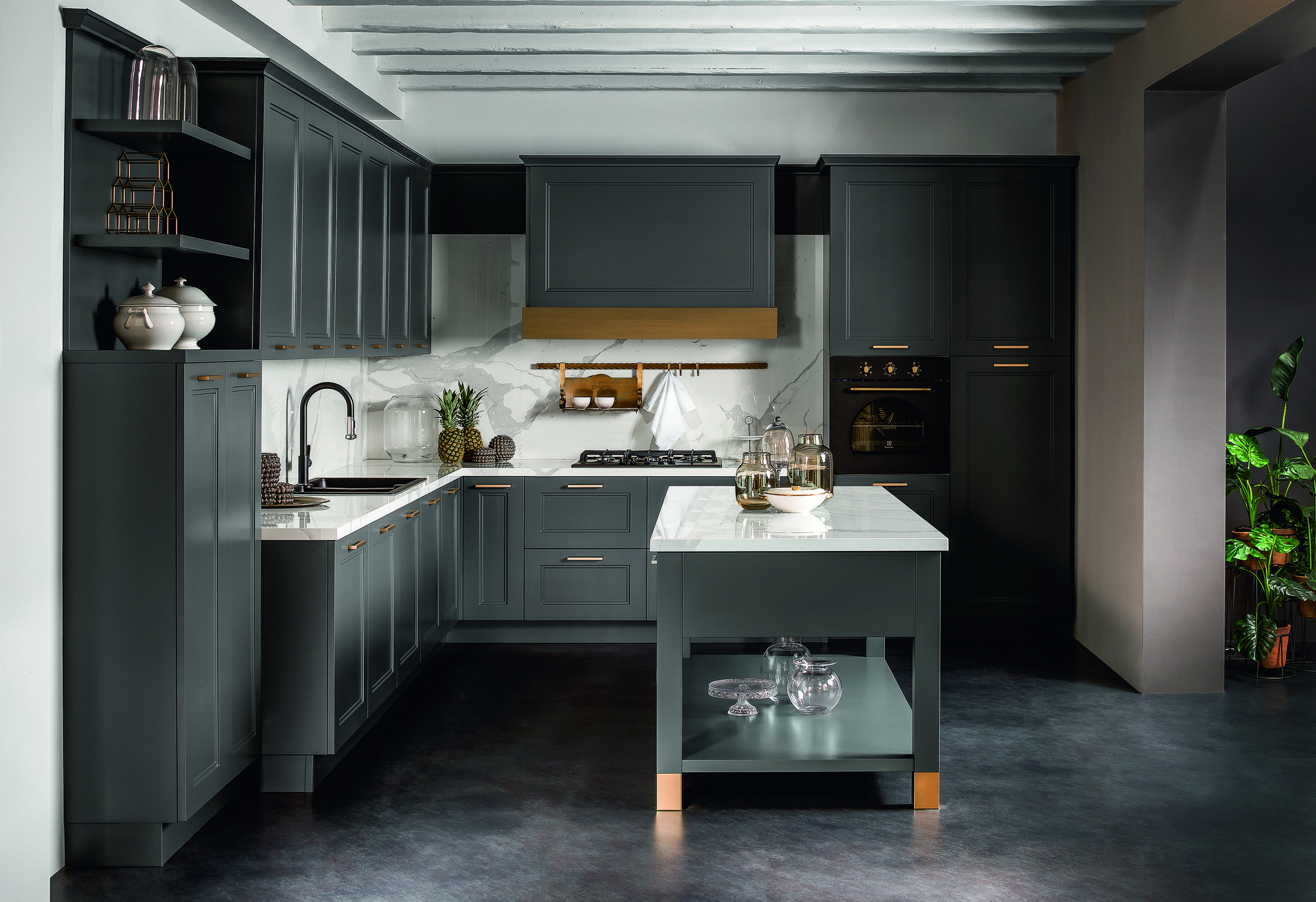 brass - a stunning accent with deep grey units.