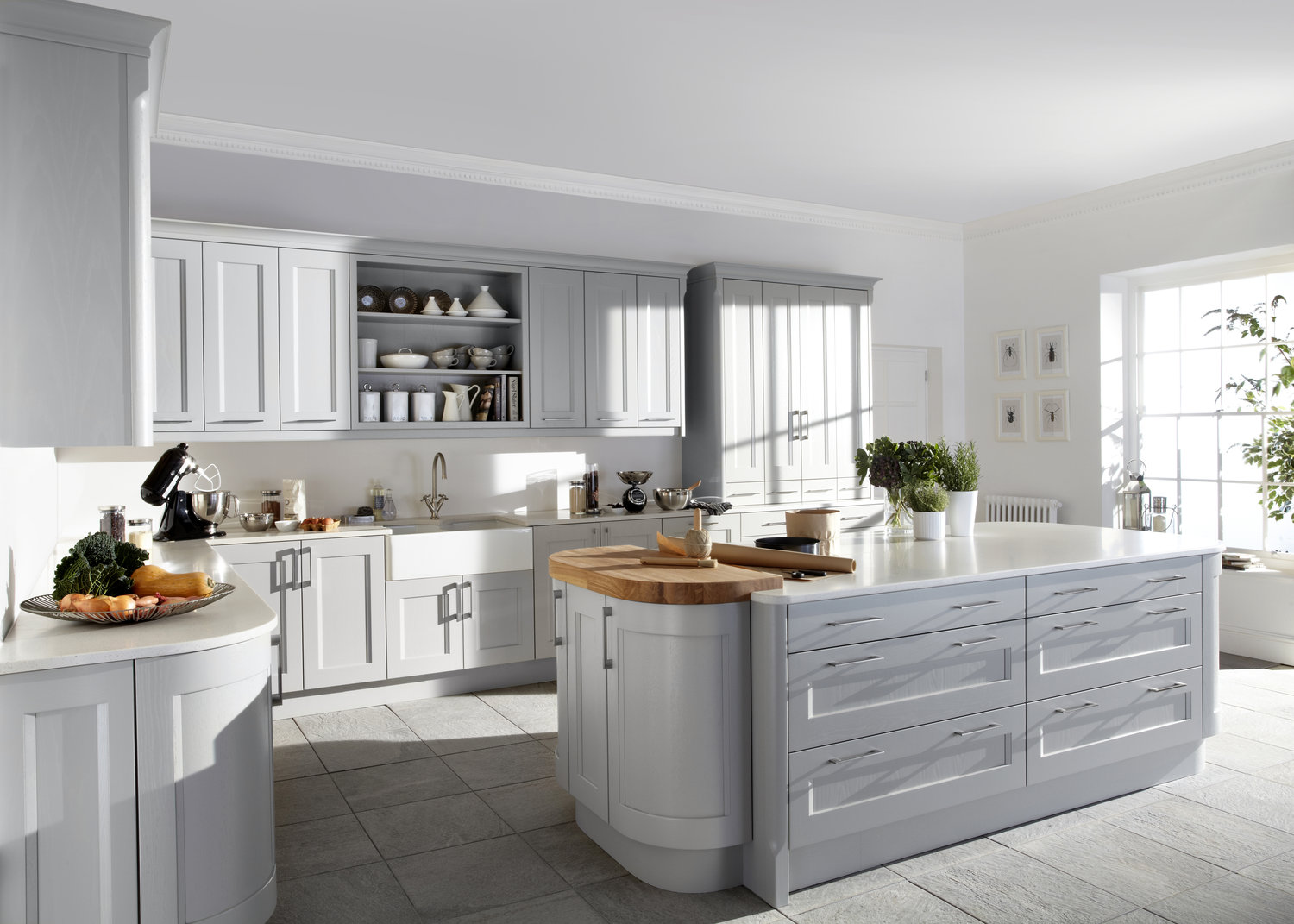 curved shaker profile doors add a softer feel in this stunning dove grey Kew kitchen.