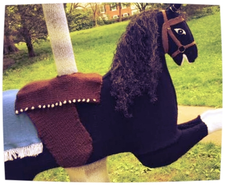 Seen in Wilcox Park. Made entirely out of knitting, and with carousel music coming from within. Don't tell me Westerly's not cool.
