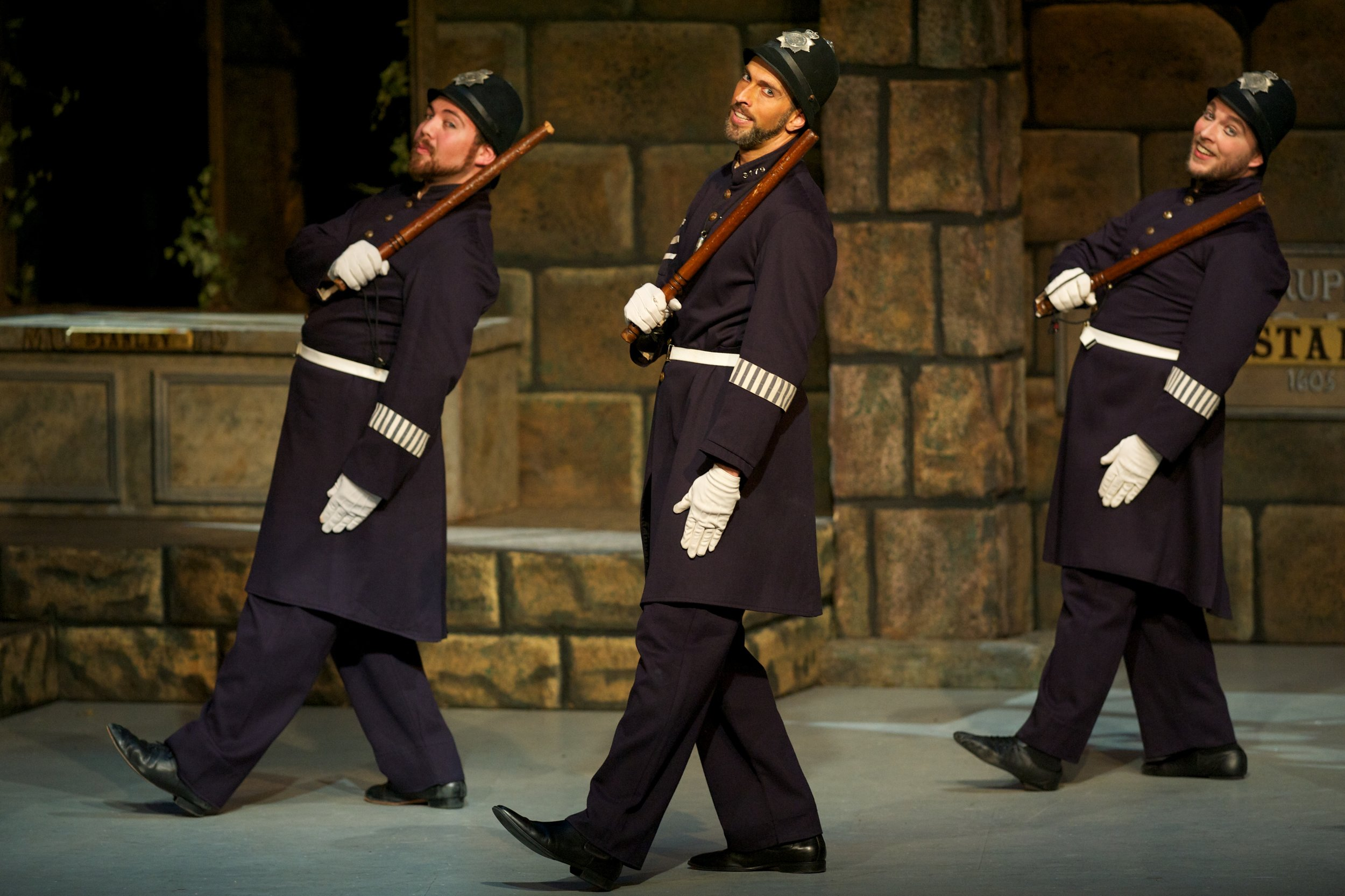 A Policeman's lot is not a happy one -  David Auxier (center) ( photo by William Reynolds )