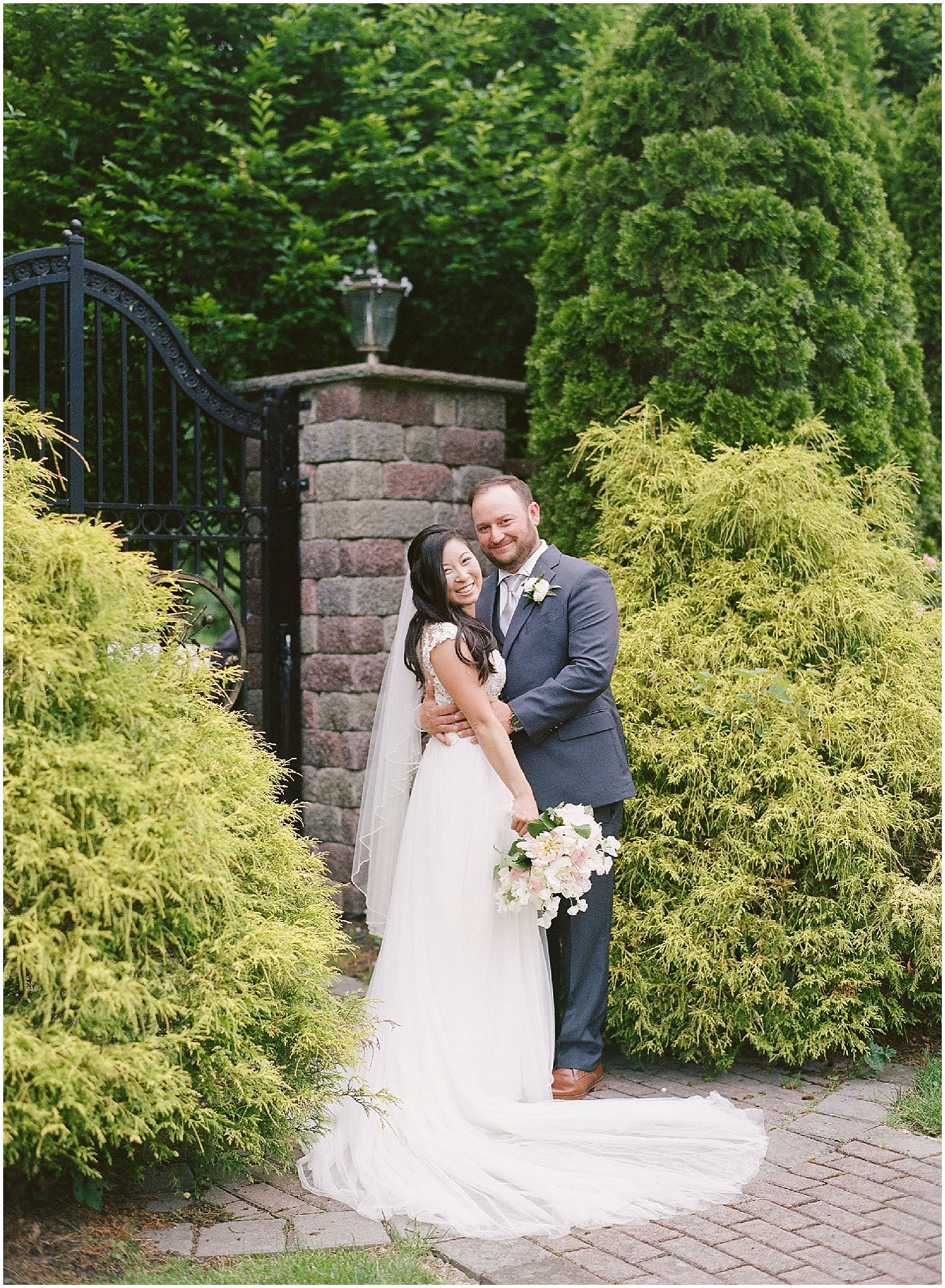 new jersey outdoor wedding, Monmouth University Wilson Hall, natural light photographer, film photographer, bride and groom looking at camera
