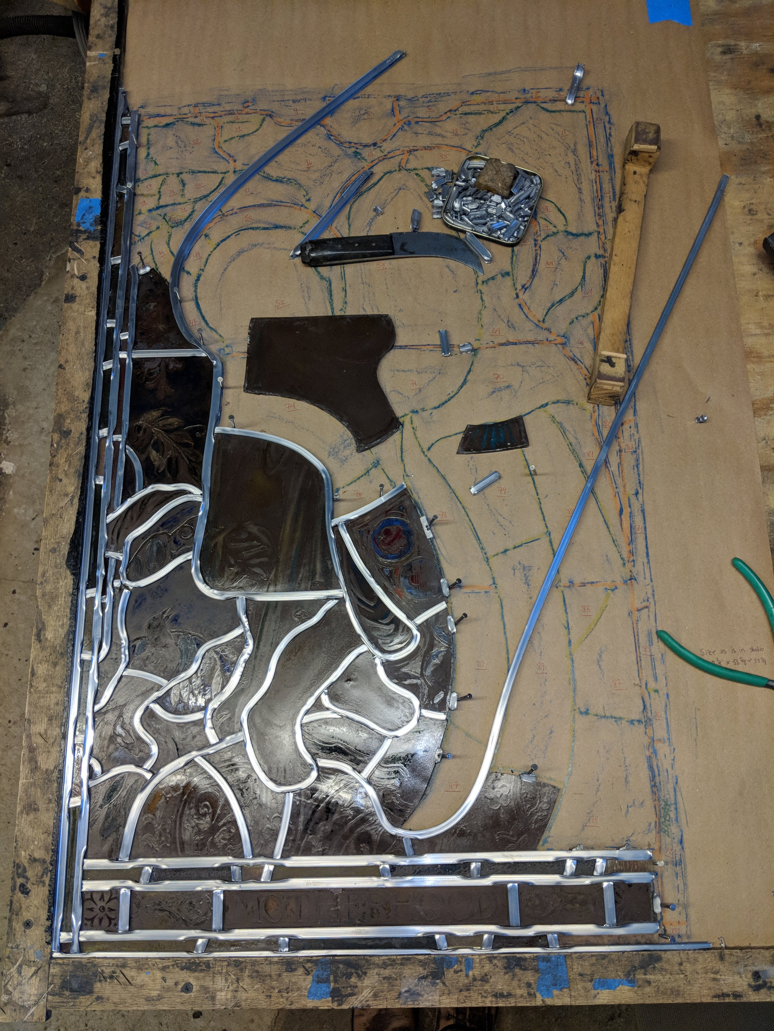 Once all pieces have been repaired or replaced, the panel is reassembled with new lead according to the pattern made at the beginning.