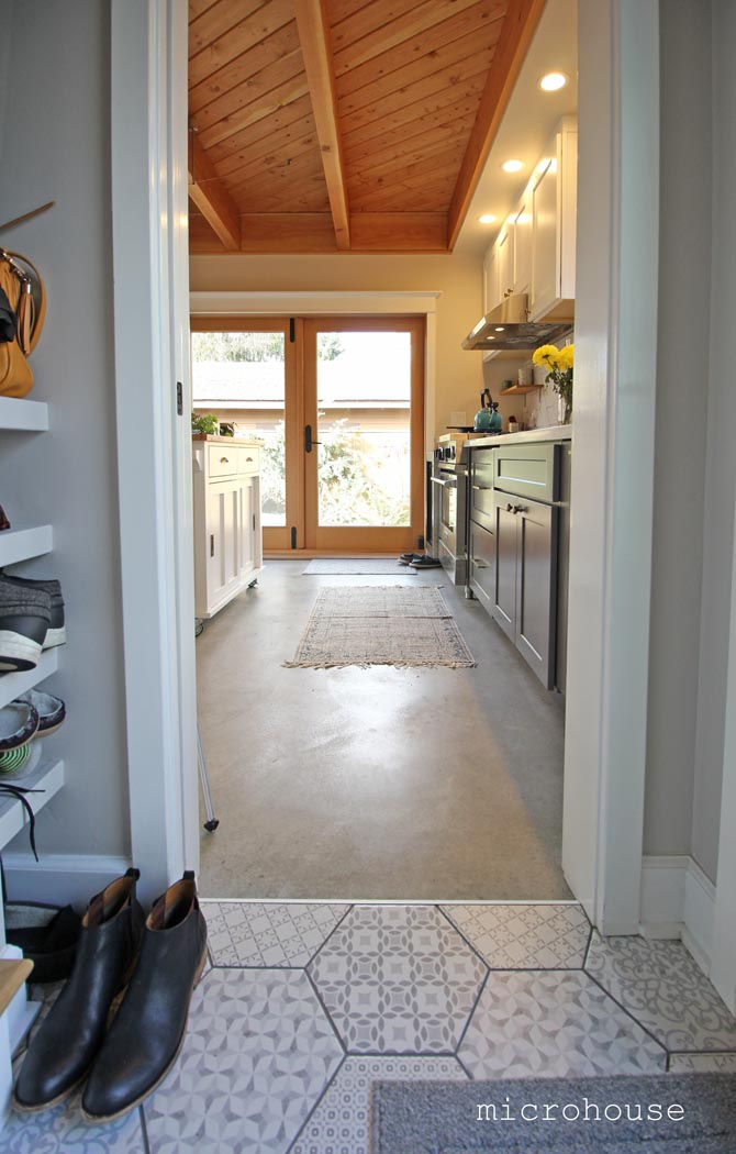 Ceramic tile accentuates the entry area.  The view from the entry towards the kitchen and patio beyond.