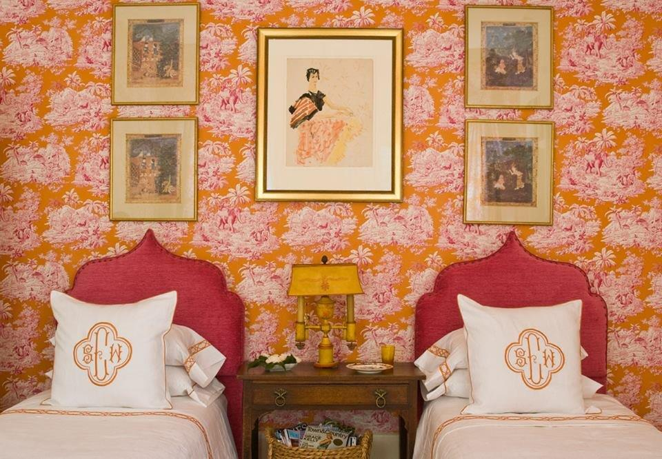 BR twin beds with orange-pink toile.jpg