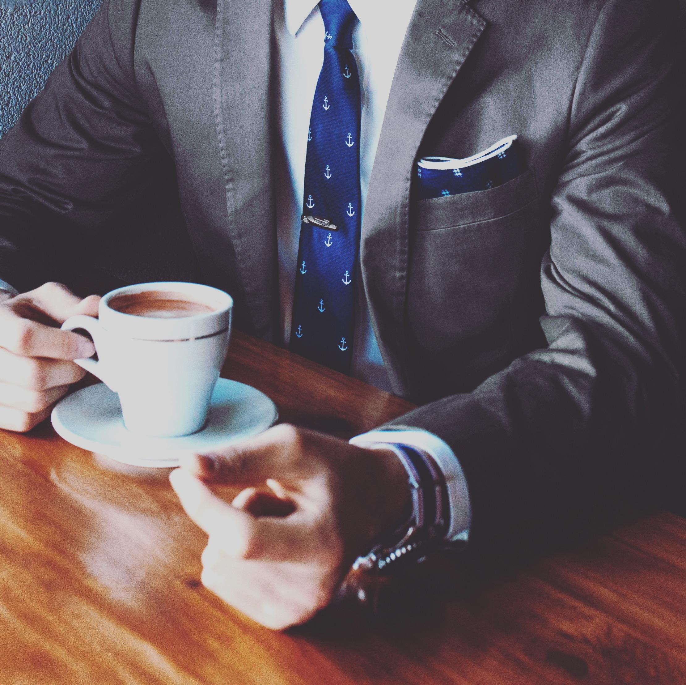 Businessman_coffee_suit_anchor_tie