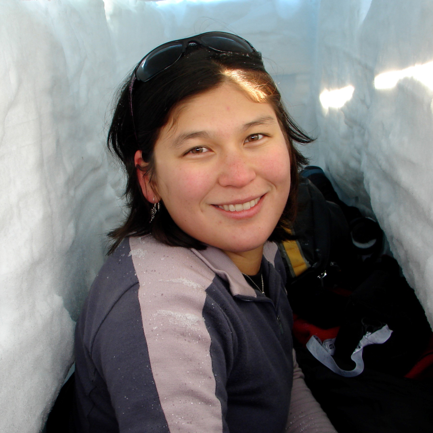 Getting ready to go to sleep in my snow trench I dug during survival training in Antarctica.