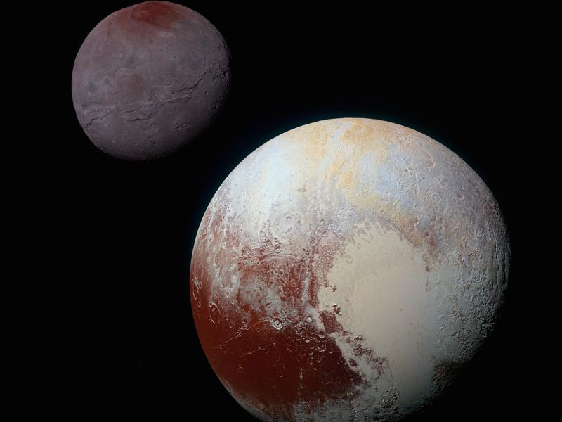 This composite image features Pluto and its largest moon Charon in enhanced color. (NASA/Johns Hopkins University Applied Physics Laboratory/Southwest Research Institute)