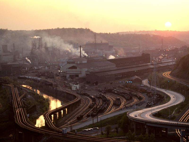 """""""I was elected to represent the citizens of Pittsburgh, not Paris,"""" President Trump said during his announcement that the United States would be leaving the Paris agreement. Pictured: a steel mill in the Monongahela Valley of East Pittsburgh in the early 1970's.(Bob Kreisel / Alamy)"""