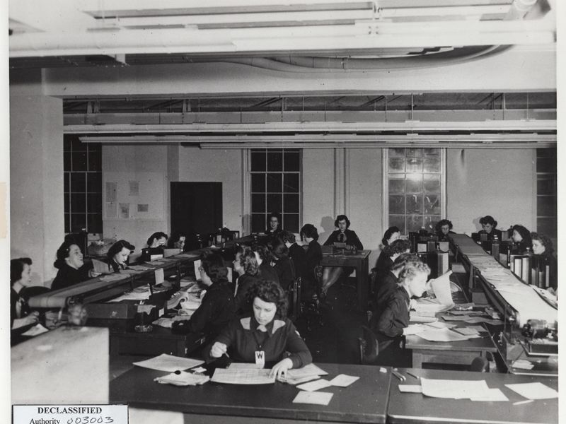 Thousands of women tirelessly worked in close quarters throughout the war breaking codes for the Army and Navy. Vowed to secrecy, they have long gone unrecognized for their wartime achievements. (National Archives and Records Administration)