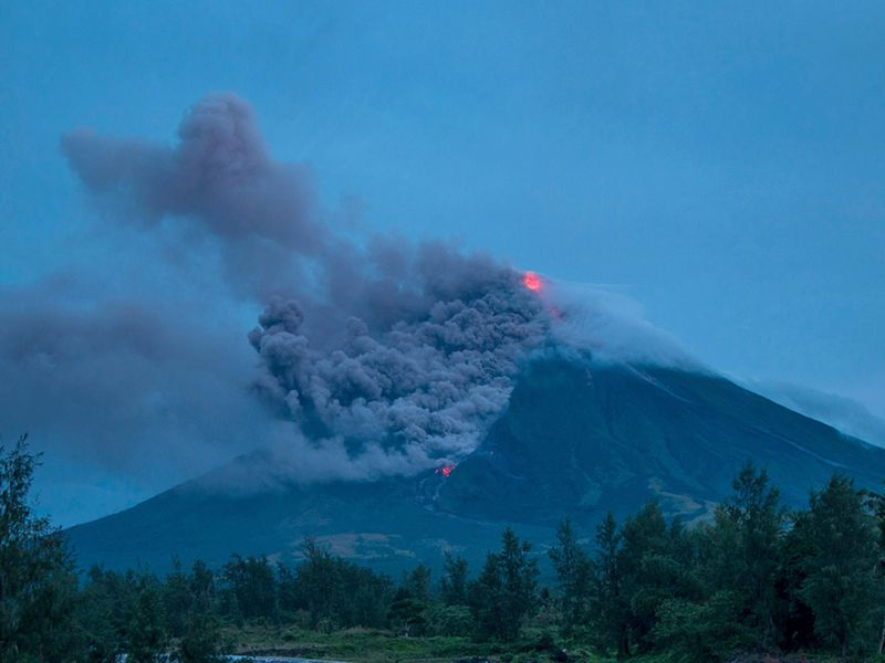 Lava cascades down the slopes of the erupting Mayon volcano in January 2018. Seen from Busay Village in Albay province, 210 miles southeast of Manila, Philippines.(AP Photo/Dan Amaranto)