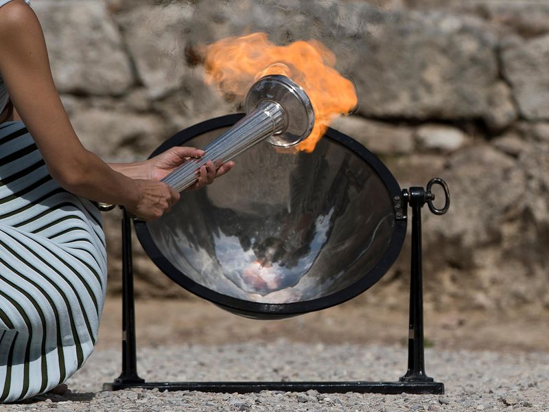 The Olympic Flame was lit from the sun's rays using a parabolic mirror, during the final dress rehearsal for the lighting ceremony at Ancient Olympia, in southwestern Greece, on Monday, Oct. 23, 2017. (AP)