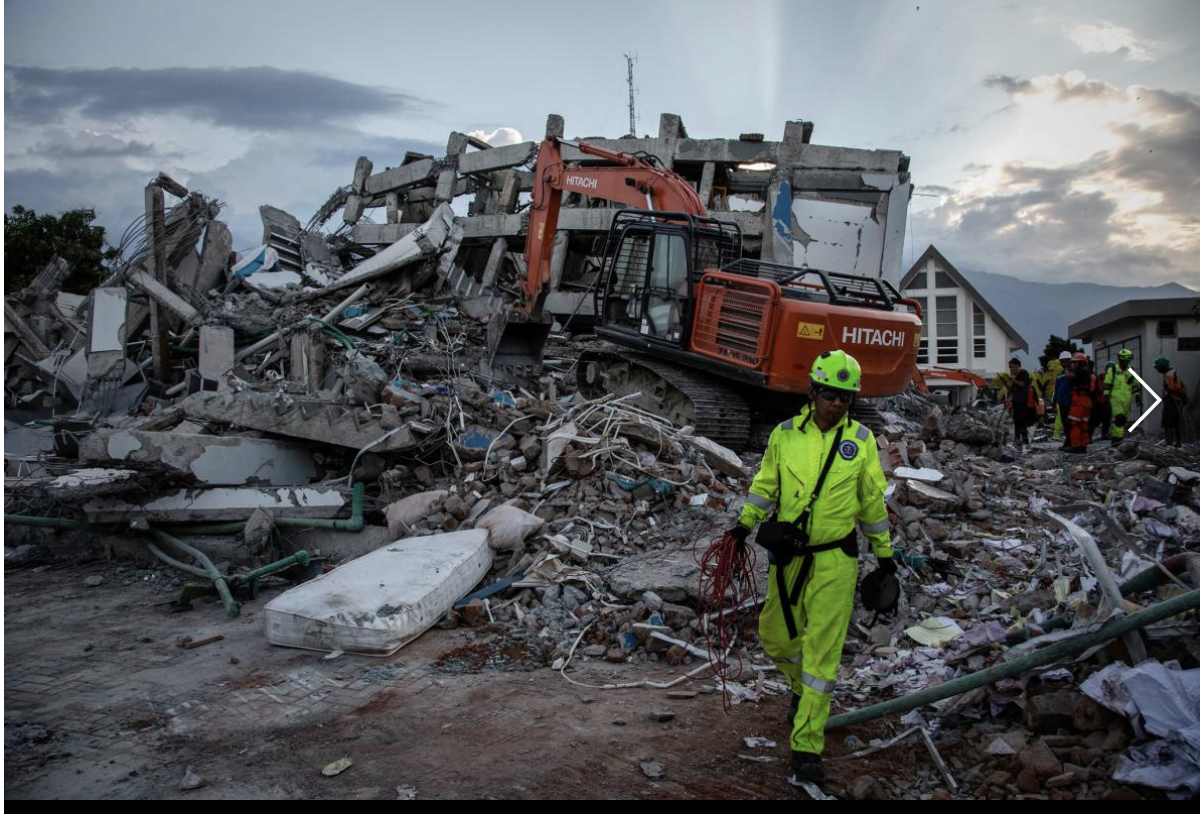 Rescue workers look for victims at the site where a hotel collapsed after an earthquake hit near Palu, Central Sulawesi, Indonesia. As of Monday more than 800 people were confirmed dead after a tsunami triggered by a magnitude 7.5 earthquake slammed into Indonesia's coastline. PHOTOGRAPH BY ULET IFANSASTI, GETTY IMAGES