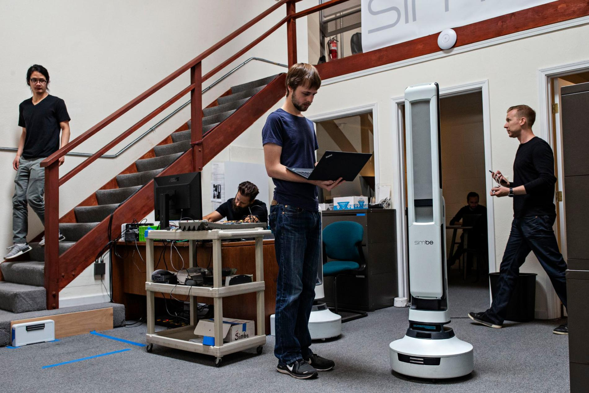 Senior robotics engineer Steven Macenski works on robot perception with the Tally robot, which is designed to scan shelves to identify objects that are misplaced, priced incorrectly, low in stock, or out of stock. PHOTOGRAPH BY LAURA MORTON