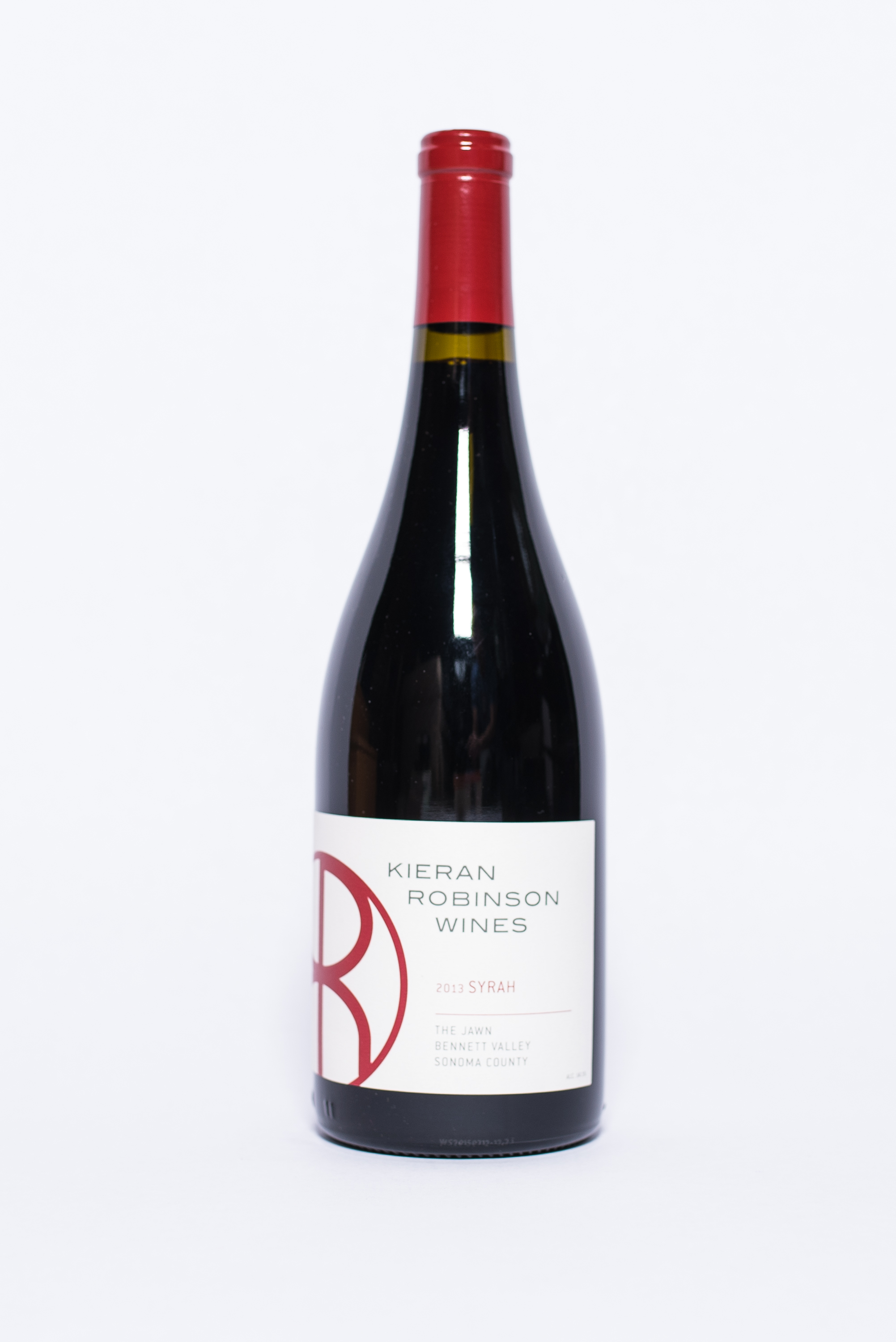 """""""The Jawn"""" Syrah 2013    Producer:   Kieran Robinson Wines    Region:  Sonoma  Grapes:  Syrah  Characteristics:  Nose of tart cherries and rose petals. Complimented by spicy notes in the front with a a long finish on the palate. Subtle hints of olive and tapenade."""