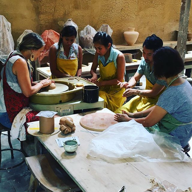 A learning moment: the basics of centering delivered with utmost patience and dexterity. Thank you @selinekocher for your skilled help in every aspect of the studio! #ceramics #studio #throwing #private #class #beginning #clay #pottery #patience #instruction #studiointern #gratitude #clayeverydamnday #eatclaylove #bali