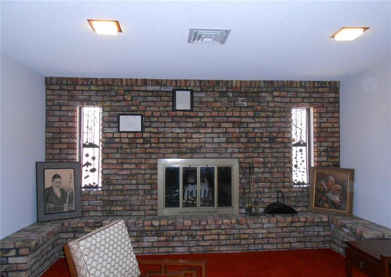 Wall to Wall Brick Fireplace Pre Remodel