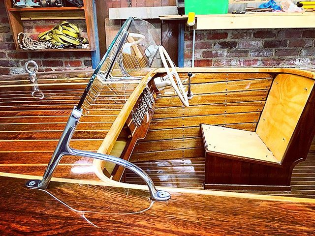 Glass installed. Windshield done! #woodwork #woodboats #boatbuilding #workshop #winshield #chrome #boat