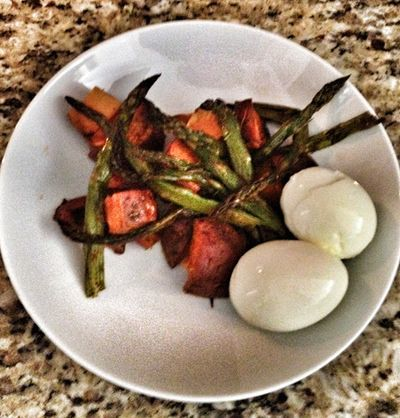 """Meal 2 - """"Taking advantage of foods that are in season is a fun and healthy way to add some color to your meals."""" Two hardboiled eggs with baked sweet potato, asparagus, and butternut squash."""