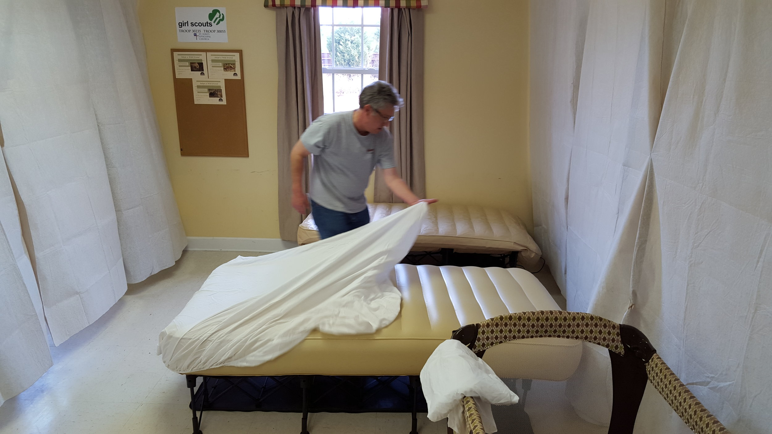 Setting up beds for Family Promise guests to stay overnight at St. Luke's for a week.