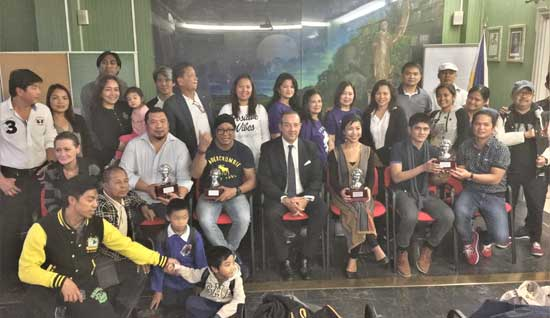 The artist (seating, second from right) during the recognition from the Philippine Embassy in Italy for the participation of Filipino artists in the 2017 Florence Biennale.