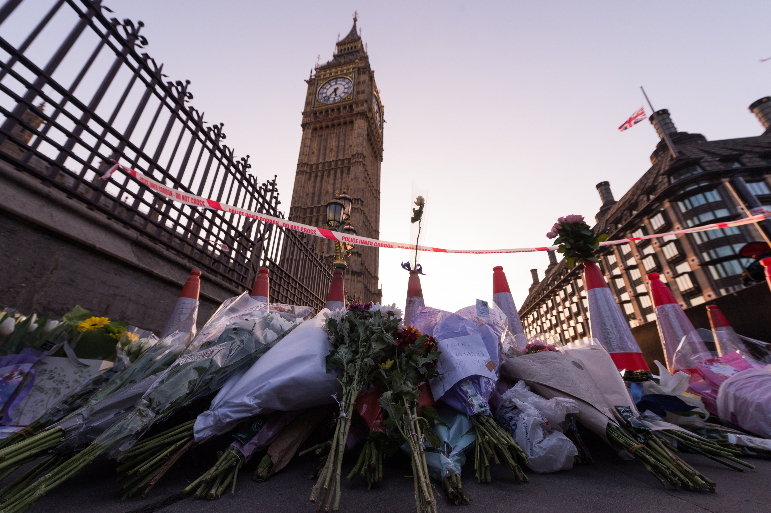 Tributes to the victims are left on the North side of Westminster bridge next to the police cordon where the attack took place.