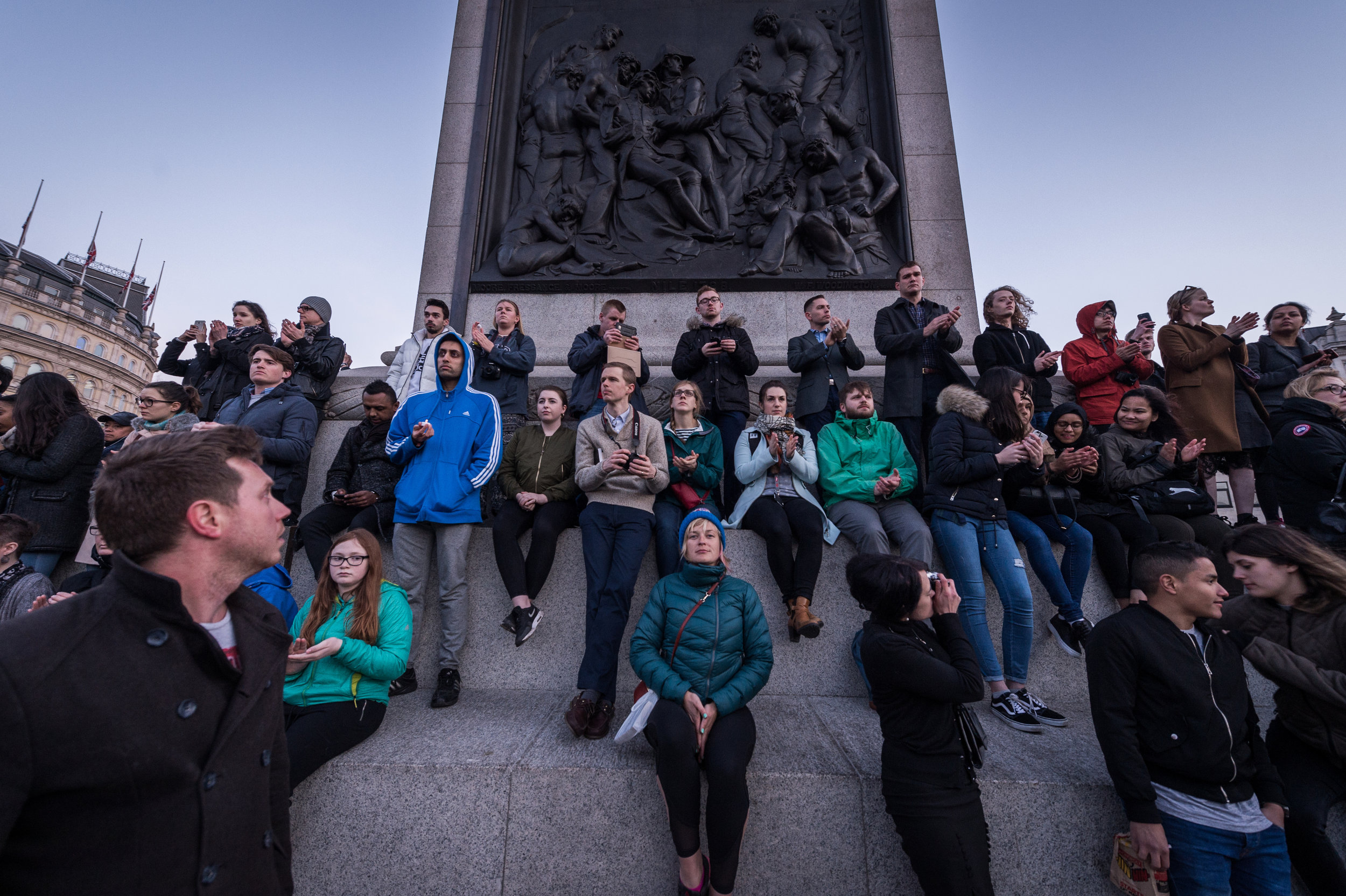 Onlookers climb Nelson's column to get a better view of the proceedings.