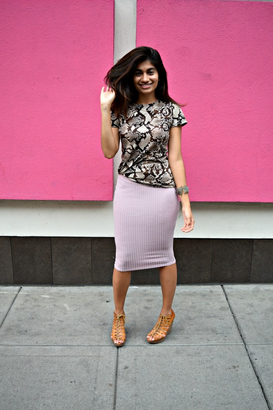 Try the tie-and-tuck method to pair a fun tee with your favorite skirt.
