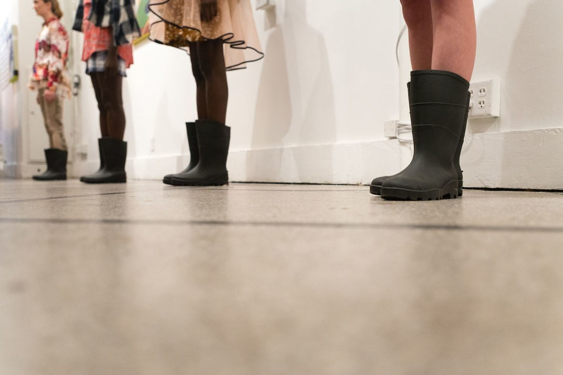 Rainboots pull the collection together and contrast with the prints and patterns of the pieces. / Photo: FWMN