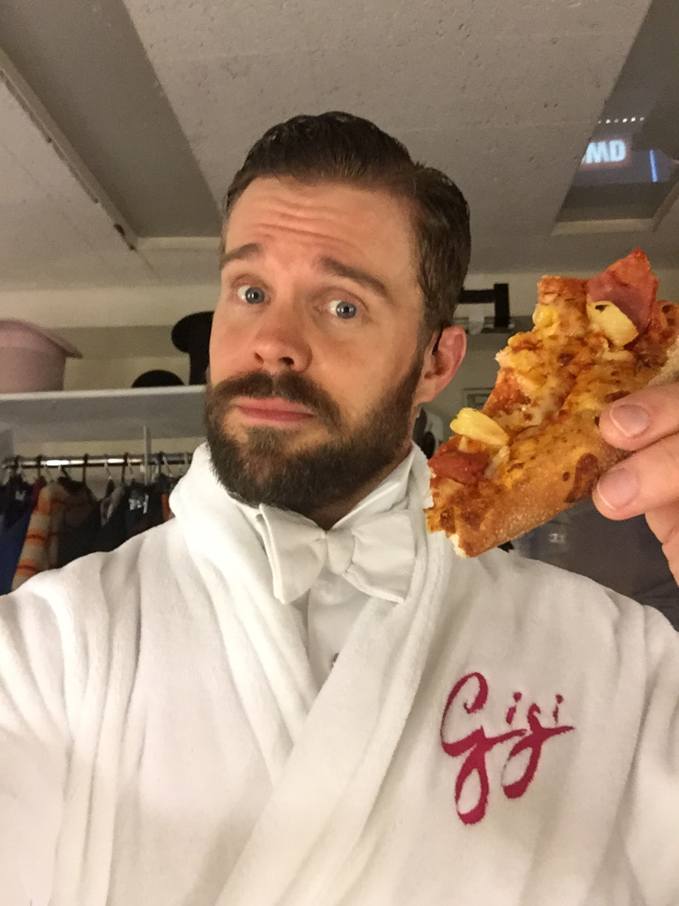 If you're going to eat pizza in a Catherine Zuber tux, be sure to wear a fancy, protective robe.
